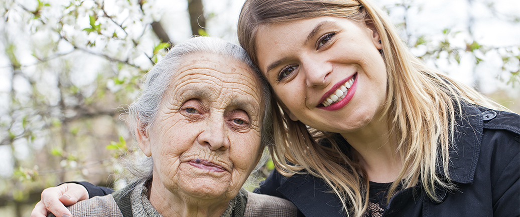 elderly woman and a young woman smiling